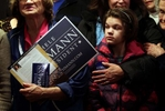 Samantha Kittle, 11, and others wait to exit the Oasis Steak House & Lounge after Republican presidential candidate Michele Bachmann met with residents in Glenwood, Iowa.