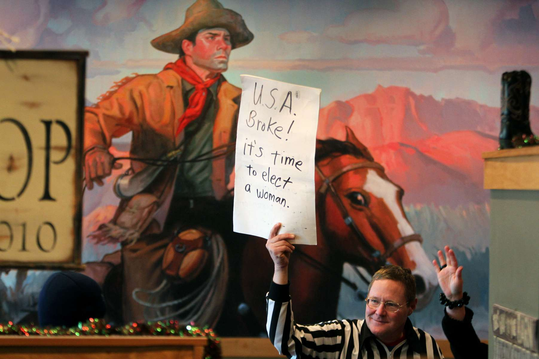 Edward Lewis of Council Bluffs, Iowa, shows his support for Republican presidential candidate Michele Bachmann at Pizza Ranch in Indianola, Iowa.