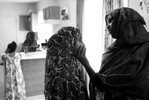 Safiya Mohamed shares a moment with her youngest daughter, Hodan Ali, 12, in their Minneapolis duplex. Safiya Mohamed says she suffers from mental illness, and that she faces challenges raising her children as a single mother in Minnesota.