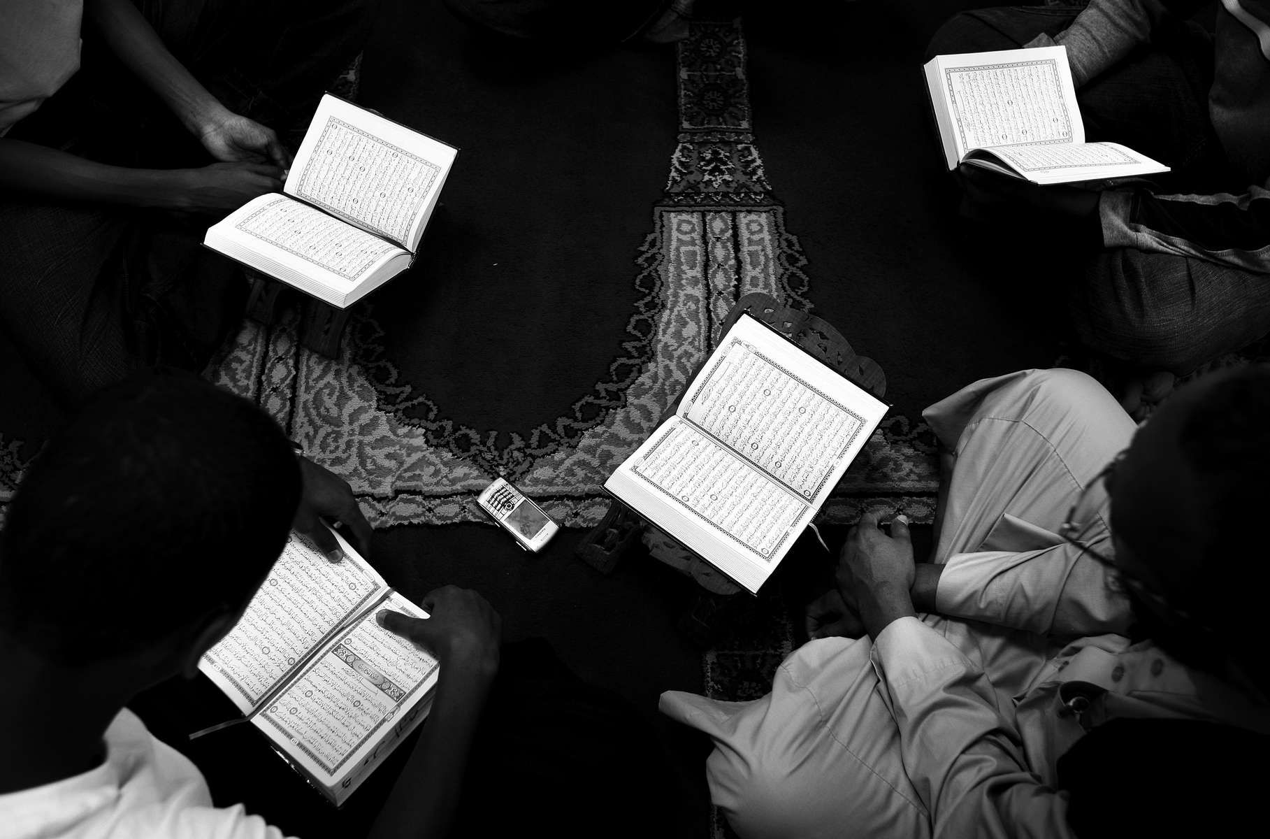 Teenagers study the Quran at the Islamic Center of St. Cloud.