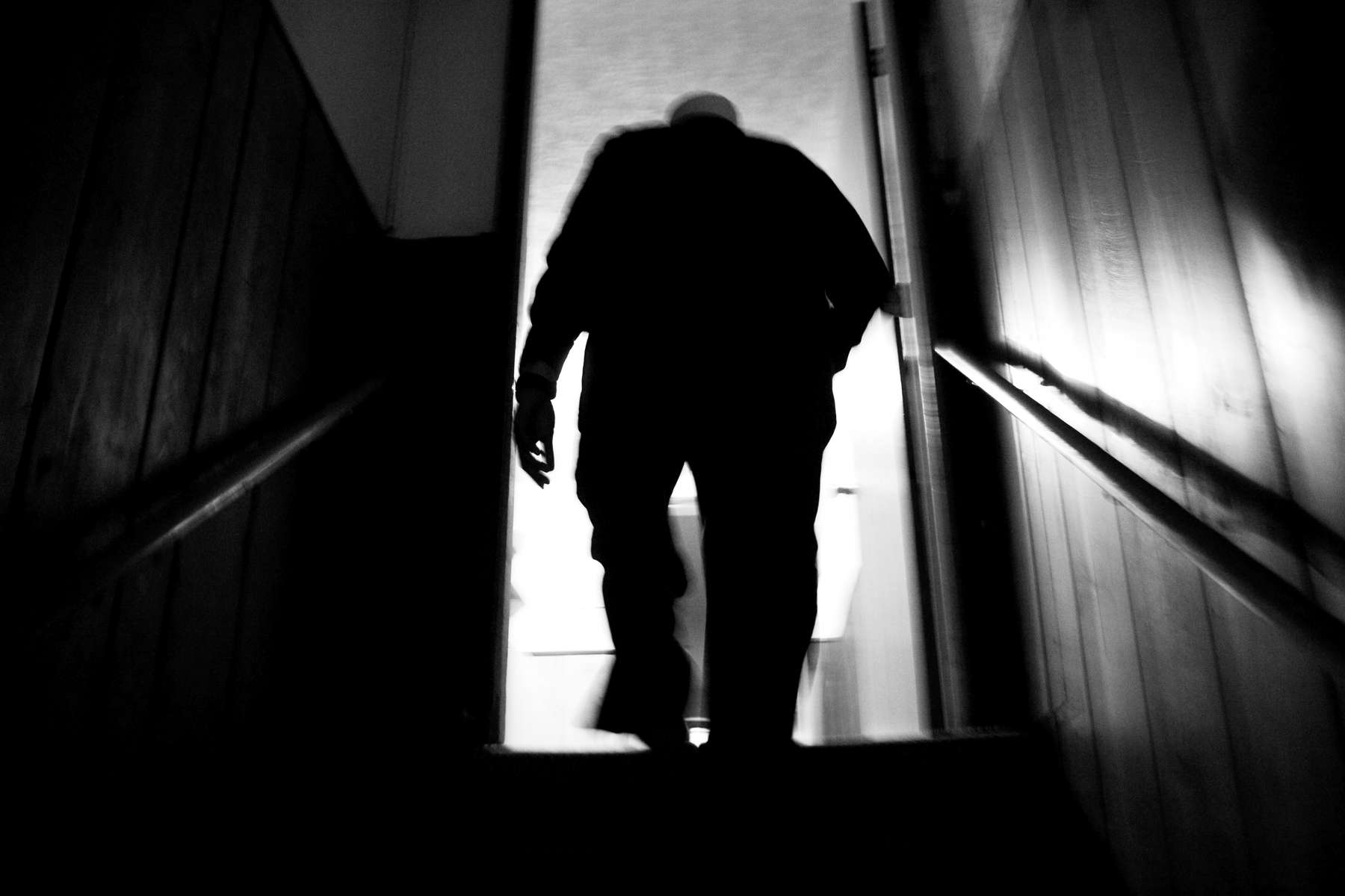 Abdulkadir Sharif ascends the stairs to his apartment above the Minnesota Da'Wah Institute in St. Paul. Sharif left a life of violence, drugs, and crime to work at Da'Wah Institute and give back to his community.