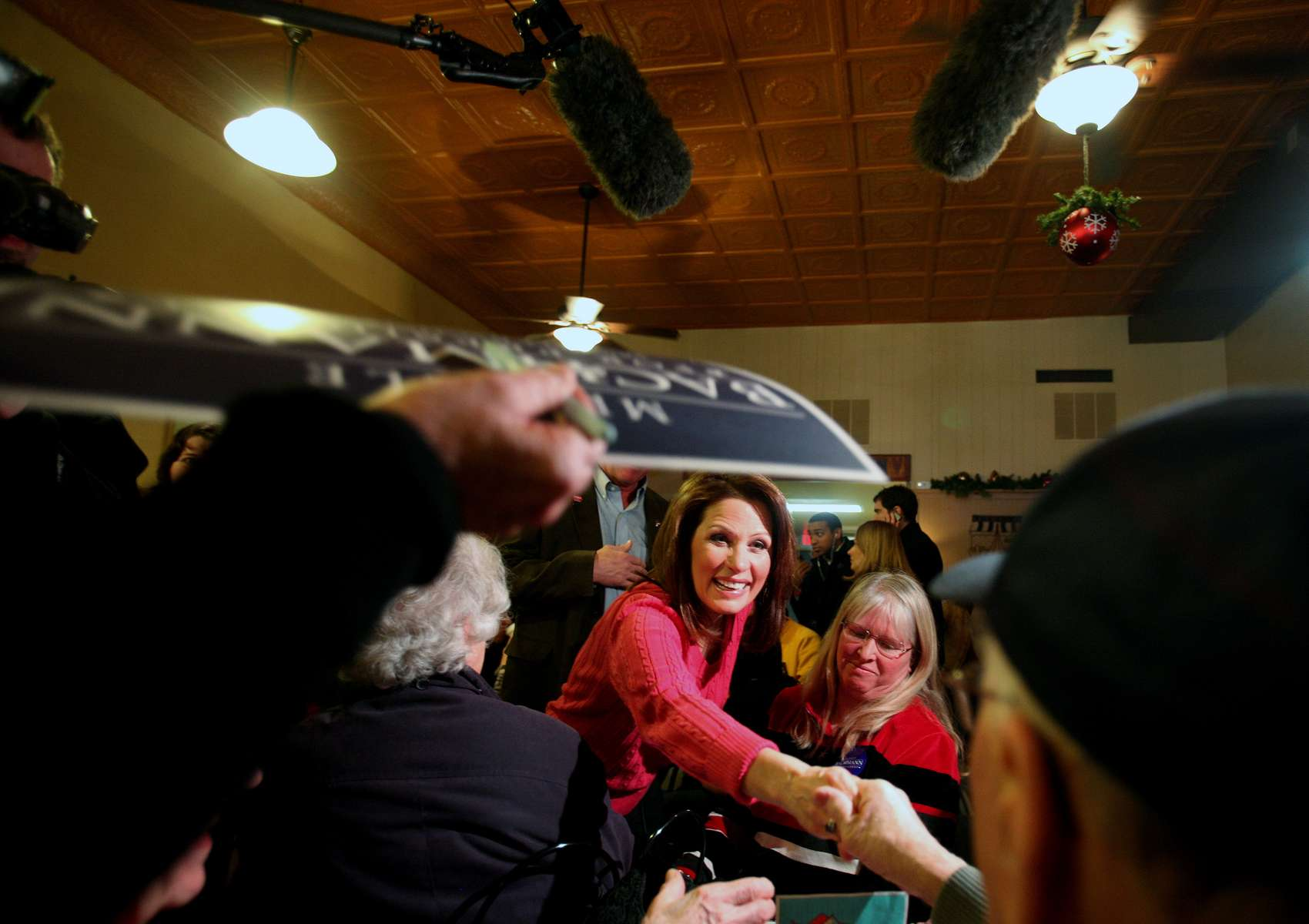 Republican presidential candidate Michele Bachmann greets supporters at Adams Street Espresso in Creston, Iowa.