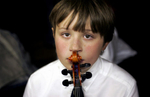 Ramsey International Fine Arts Center fourth-grader Derek Parshall waited backstage before performing with the Minnesota Orchestra in Minneapolis, Minn.