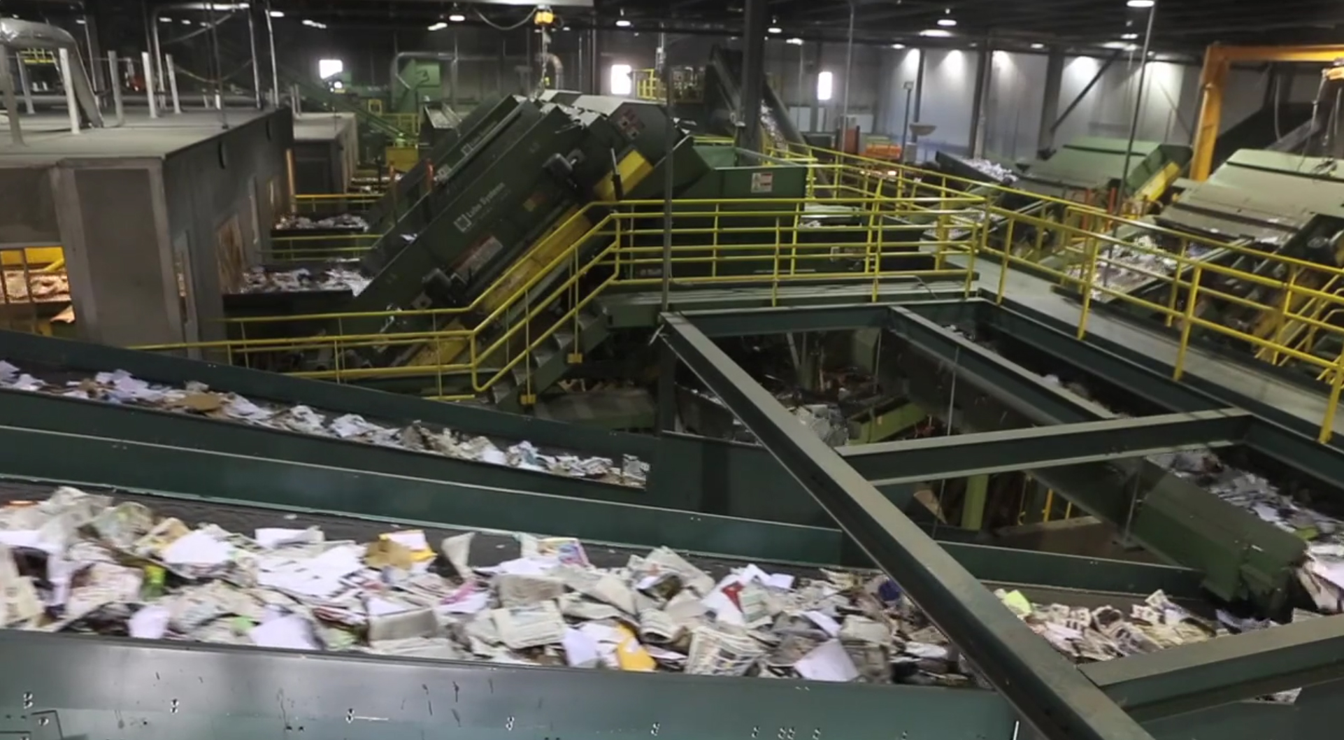 With the city of Minneapolis moving to single-sort recycling, we take a look at how our recyclables are processed at Waste Management's Materials Recovery Facility and RockTenn's recycling center.