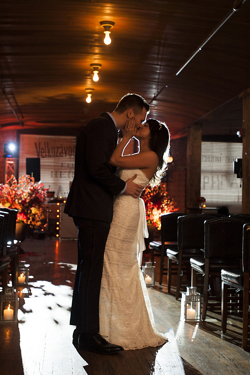 Bride and groom kissing on their wedding day at Kolo Klub. Hoboken wedding photos