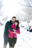 engaged couple during their snowy winter Hoboken engagement session. Hoboken wedding photographers