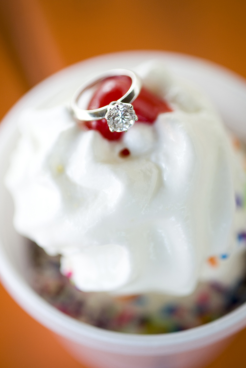 creative ring shot at ice cream shop during engagement session. Hoboken wedding photographers