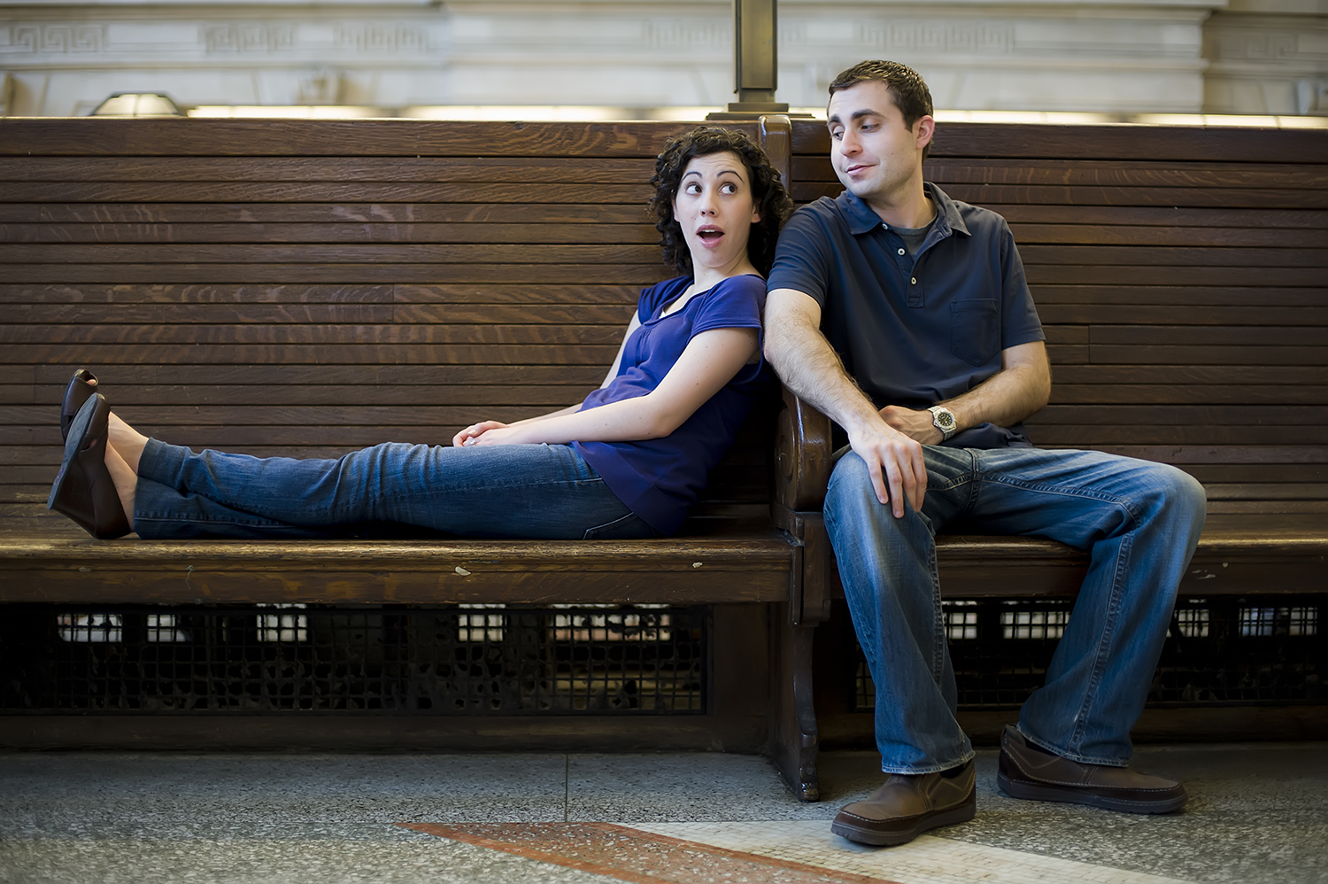 portrait of engaged couple in Hoboken train station. Hoboken wedding photographers