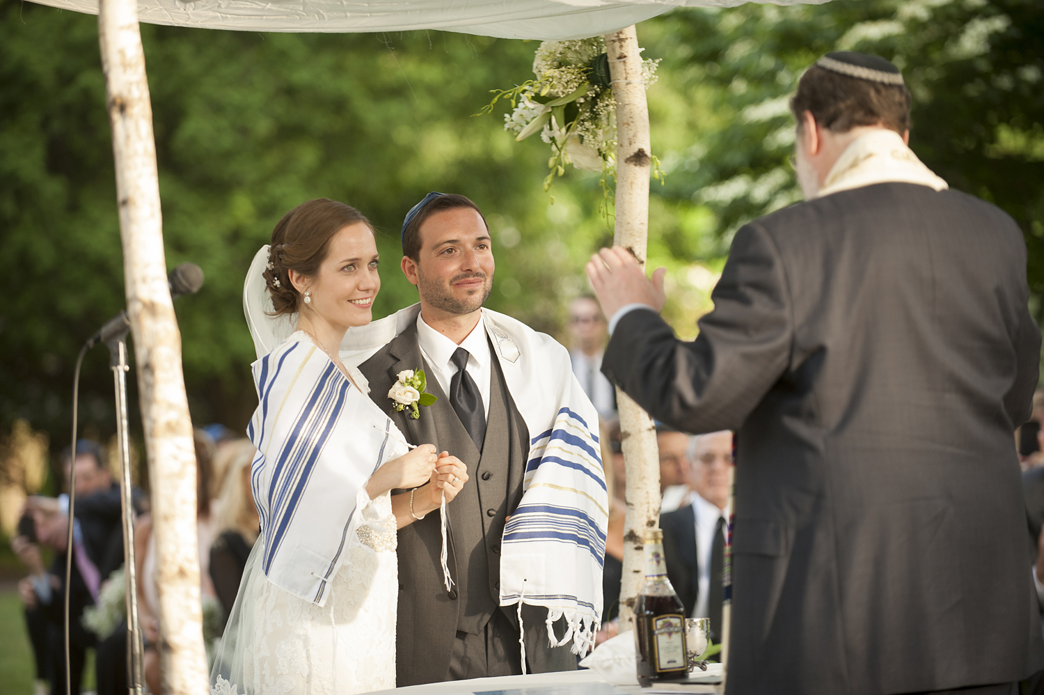 bride and groom under chuppah at Jewish wedding. NJ wedding photographers