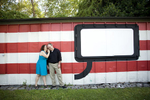 couple at Socrates Sculpture Park in Queen for engagement photos. Queens wedding photographers