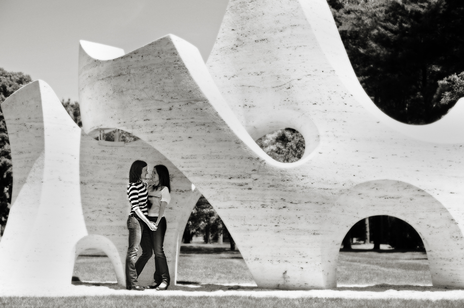 Couple in Pepsi-Co sculpture gardens. Gay-friendly NYC wedding photographers