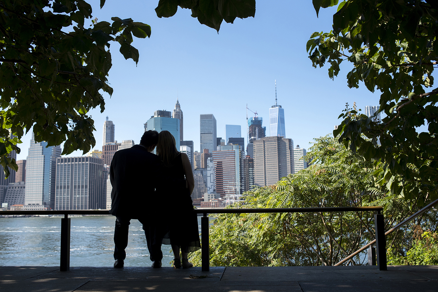 couple against NYC skyline during the engagement session. NYC wedding photographer