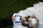 bride and groom laying in the grass at Celebrate at Snug Harbor
