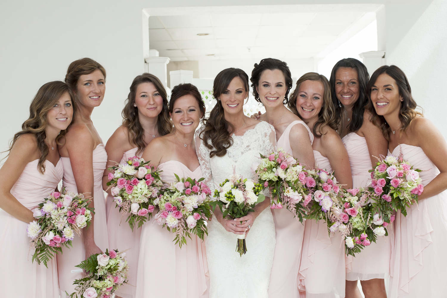 bride with bridesmaids on wedding day. NJ wedding photographers