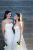 brides laughing together on their wedding day. Lesbian wedding. NYC wedding photographers