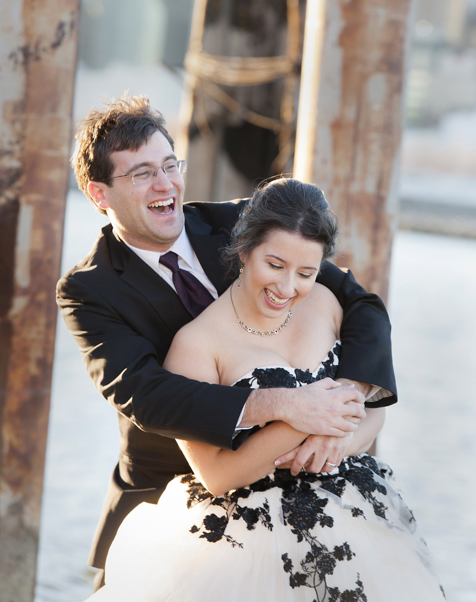 black and white wedding dressed bride and her groom laughing
