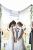 Brides under the chuppah at a Jewish wedding ceremony. NYC wedding photos