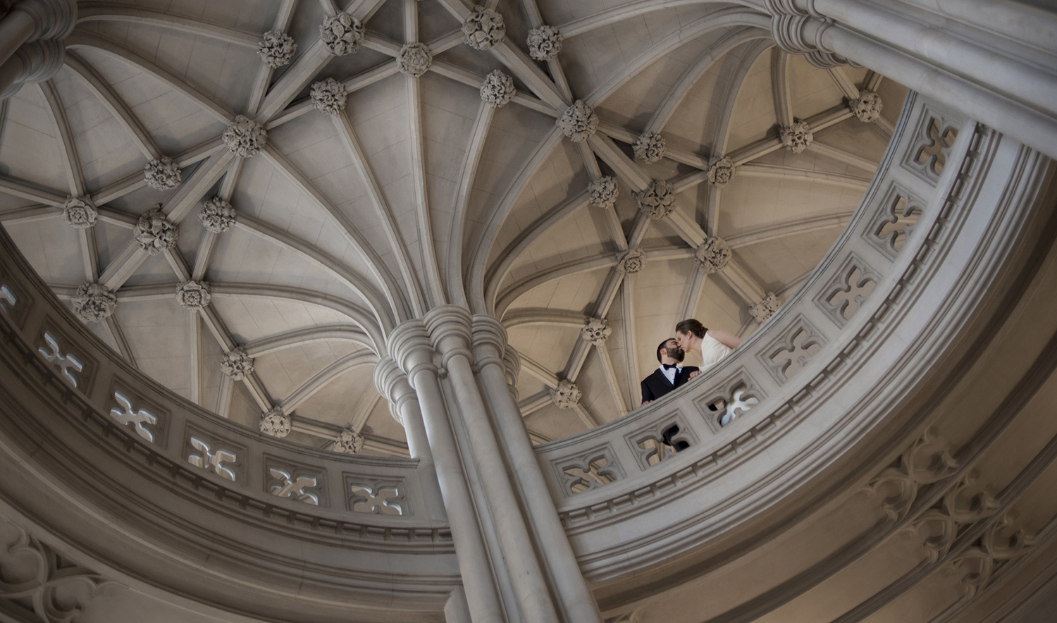 Union Theological Seminary wedding photos. bride and groom kissing in the rotunda on their wedding day. NYC wedding photos