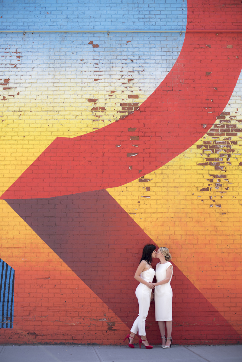 Brooklyn DUMBO colorful murals wedding photos. Same sex wedding, gay marriage, brides. Brooklyn wedding photos
