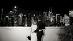 bride and groom against the NYC skyline. NYC wedding photographers