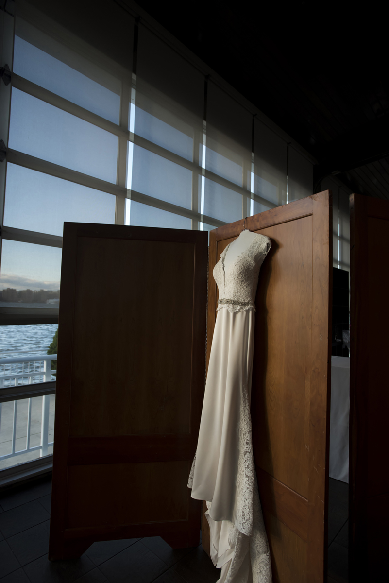 wedding dress hangs in sunlight at The Lighthouse at Chelsea Piers, New York City