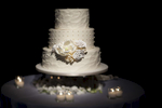 white wedding cake with white flowers, NYC wedding photographers