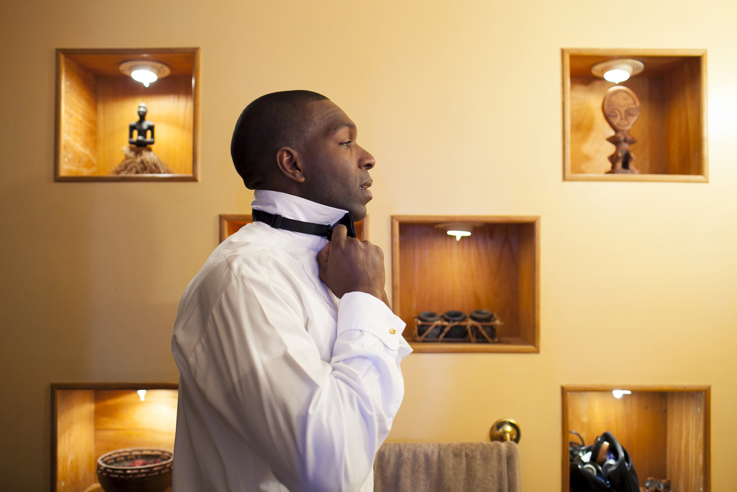 Groom preparing to get dressed for his wedding. Brooklyn wedding photographers