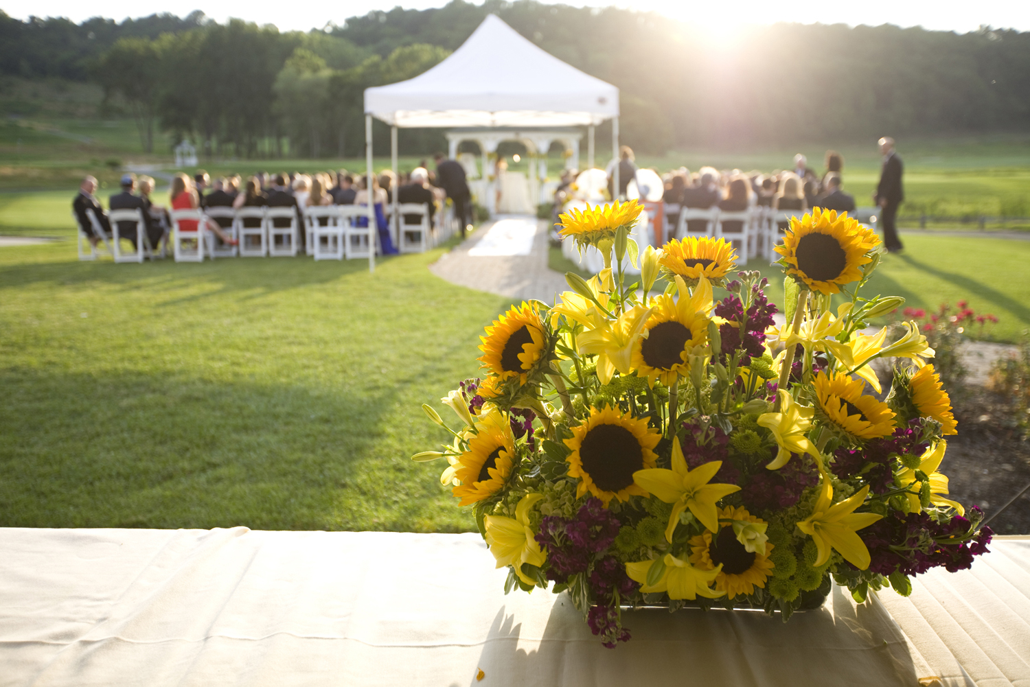 sunflowers set the scene for wedding ceremony at Harbor Links. Long Island wedding photographers