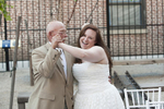 bride dances down the aisle with father at start of her wedding ceremony at BLDG 92 in Brooklyn. Brooklyn wedding photographers