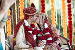 Bride and groom kiss at the conclusion of Indian wedding ceremony. NYC wedding photographers