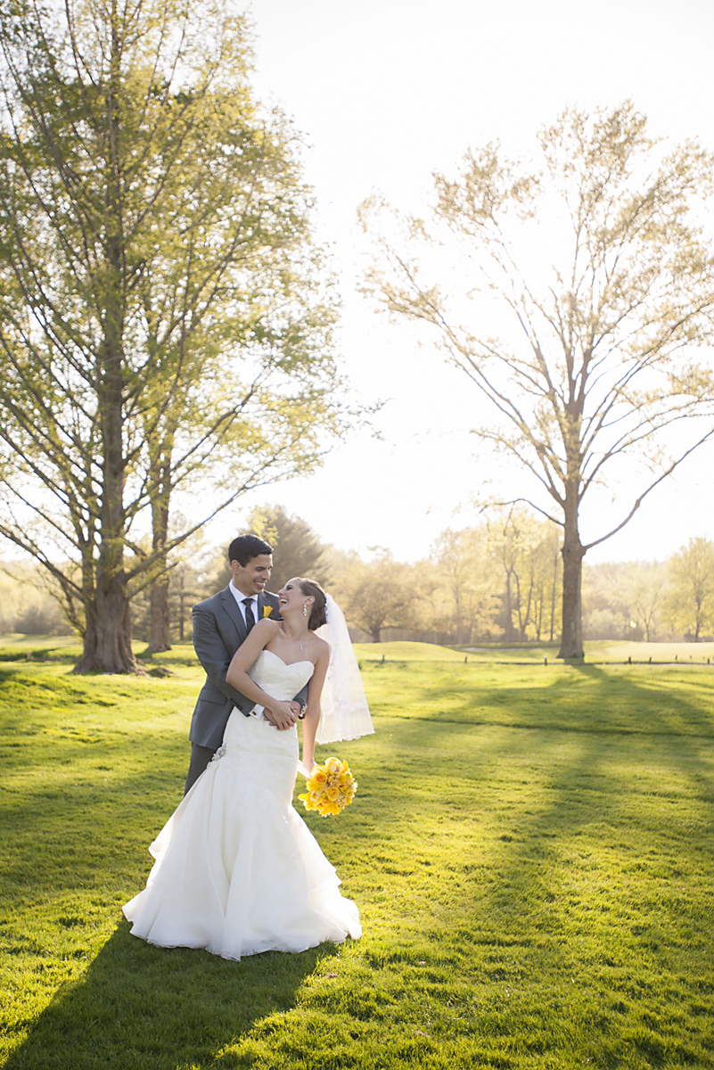 Bride and groom portrait as they bask in the sunlight during their wedding day at Preakness Hills Country Club. NJ wedding photos