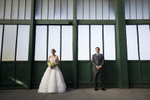 Bride and groom posing at train station in Liberty State Park before their wedding at Liberty House.
