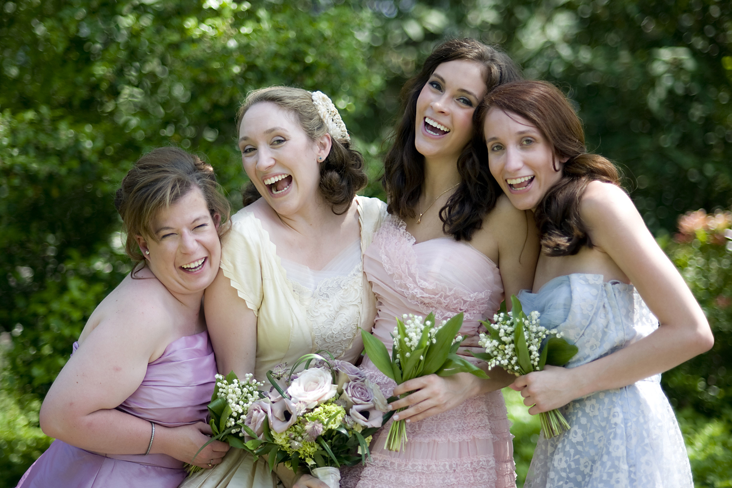Bride with bridesmaids on her wedding day at The Grand Colonial. NJ wedding photos