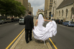 Bride and groom on their wedding day walking down the street in Philadelphia. Philly wedding photos