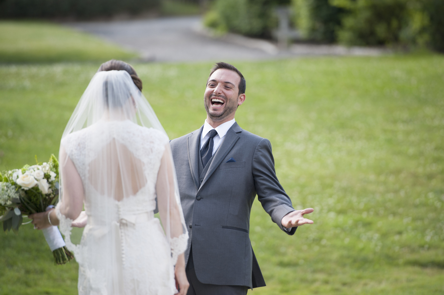 groom reacts when seeing bride for first time on their wedding day at the Orange Lawn Tennis Club
