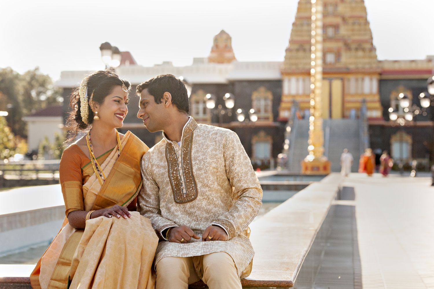 Indian wedding couple outside temple on their wedding day. NJ wedding photographers
