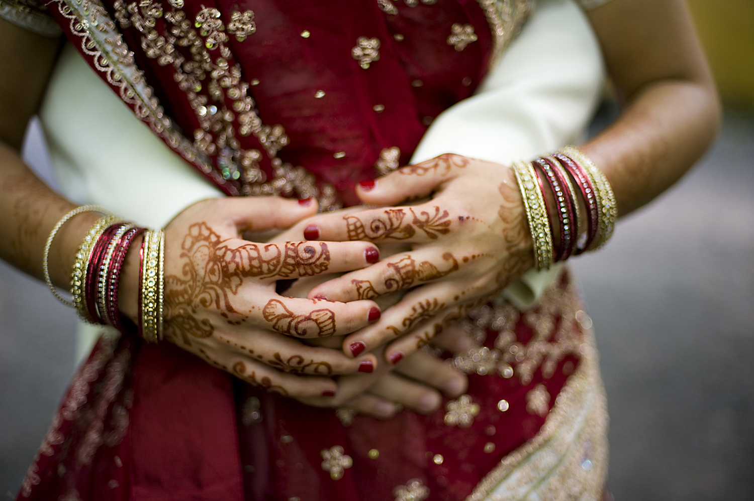Detail of henna designs on hands of bride before wedding at Grounds for Sculpture. NJ wedding photographers