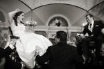 Bride and groom raised in chairs during traditional jewish dance, hora, at Pleasantdale Chateau. NJ wedding photographers