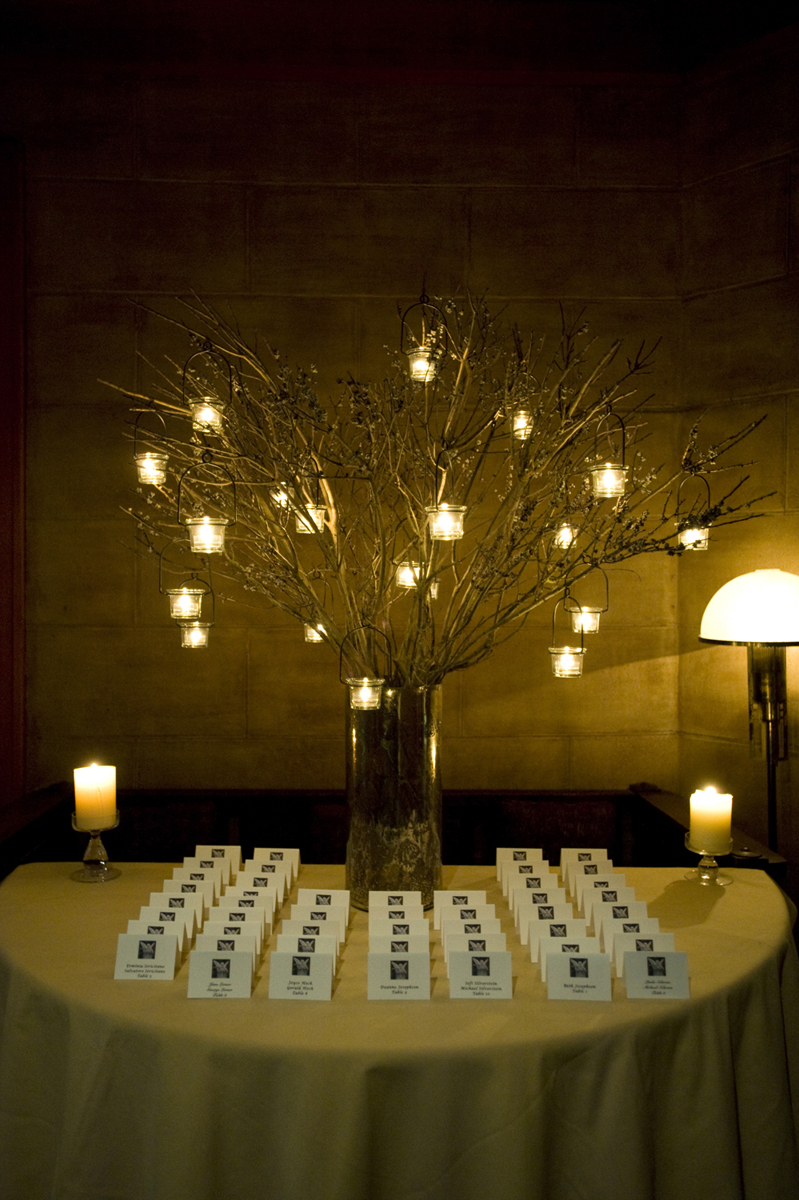 placecards lit by candle light at NYC restaurant for wedding