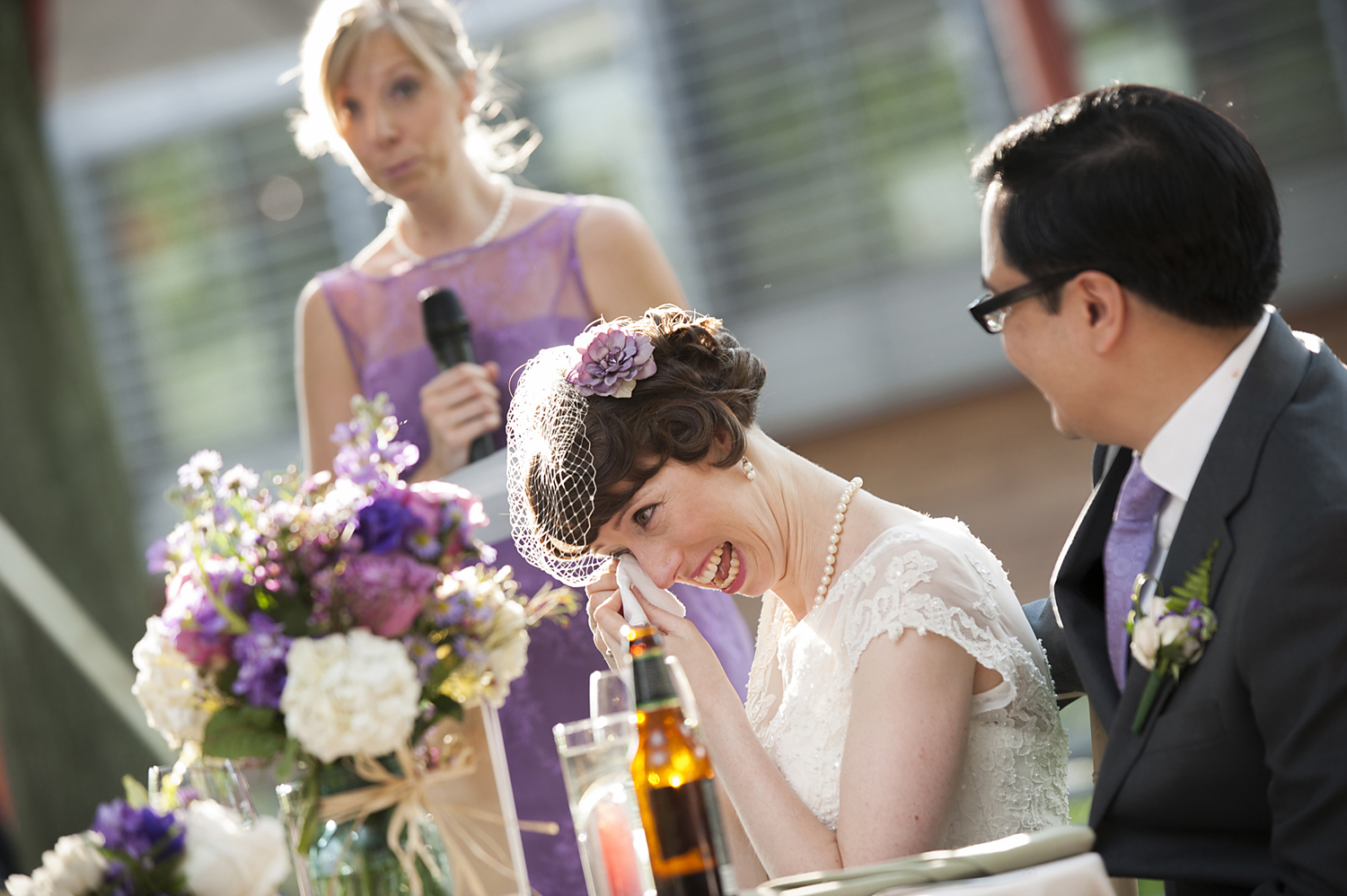 bride wipes away tear during her sister's toast at Queens Botanical Garden wedding