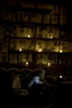 boy watching ipad during wedding at reBar in Brooklyn. Candlelight room illuminated only by screen of the ipad. Brooklyn wedding photographers