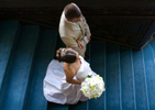 Overhead angle of bride and groom descending stairs at their wedding. NYC wedding photographers