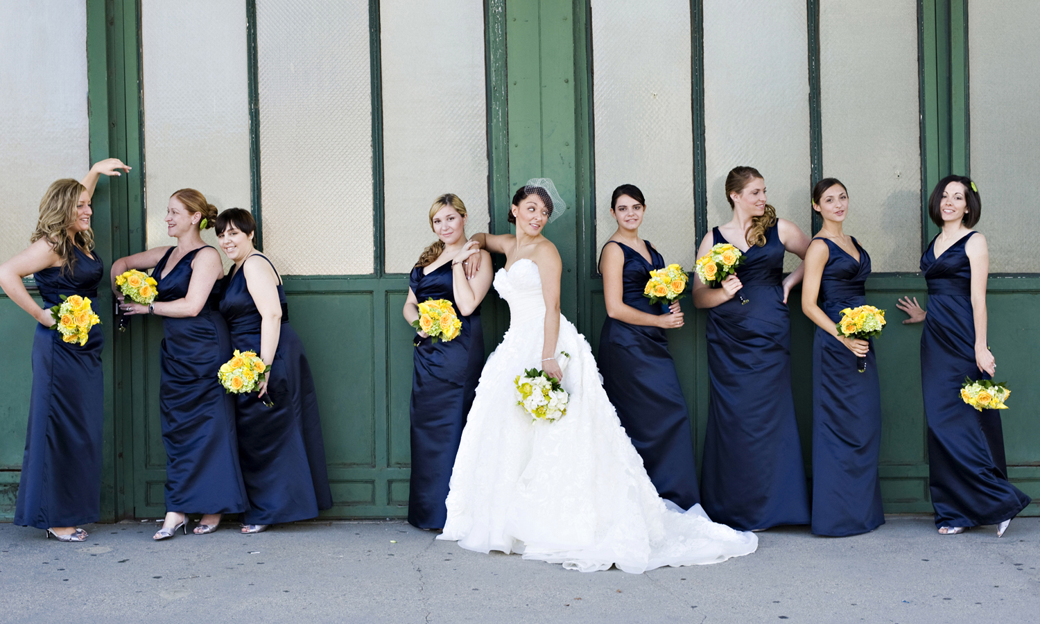 Portrait of bride and bridesmaids at train station at Liberty State Park before wedding in Liberty House. Hoboken wedding photographers, NJ wedding photographers
