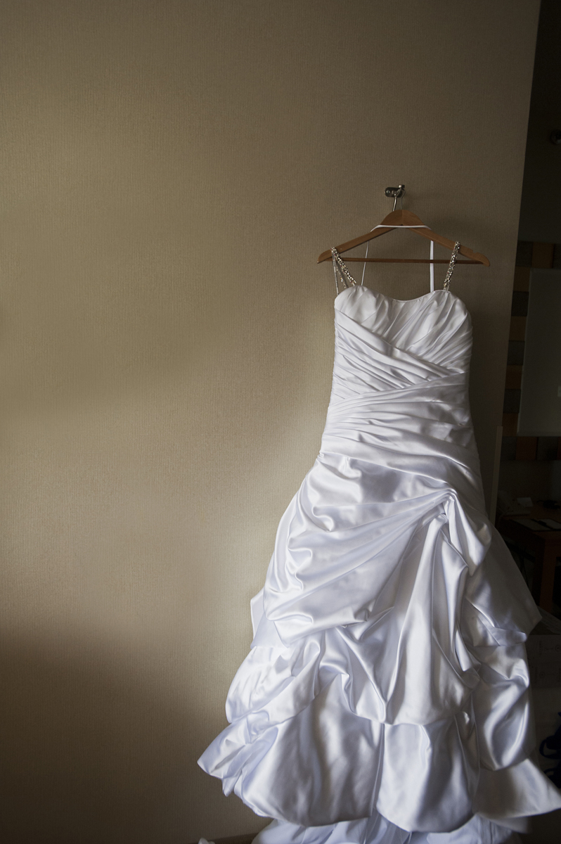 wedding dress hanging as bride prepars for her wedding at Liberty House. NJ wedding photographers