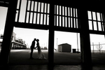 bride and groom kiss at the Asbury Park Casino on the Asbury Park Boardwalk. Asbury Park wedding photographer
