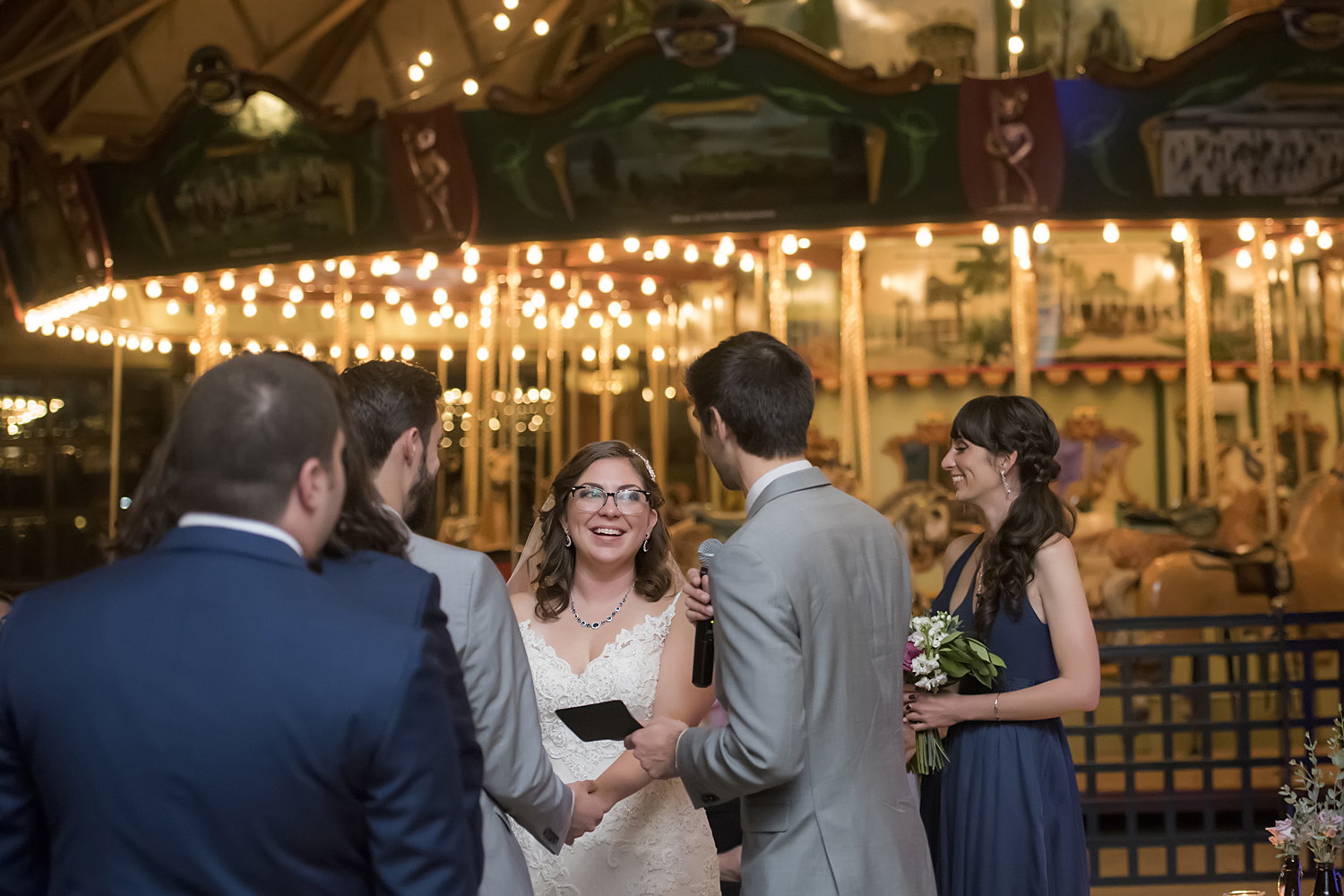 wedding ceremony in front of carousel at Bear Mountain