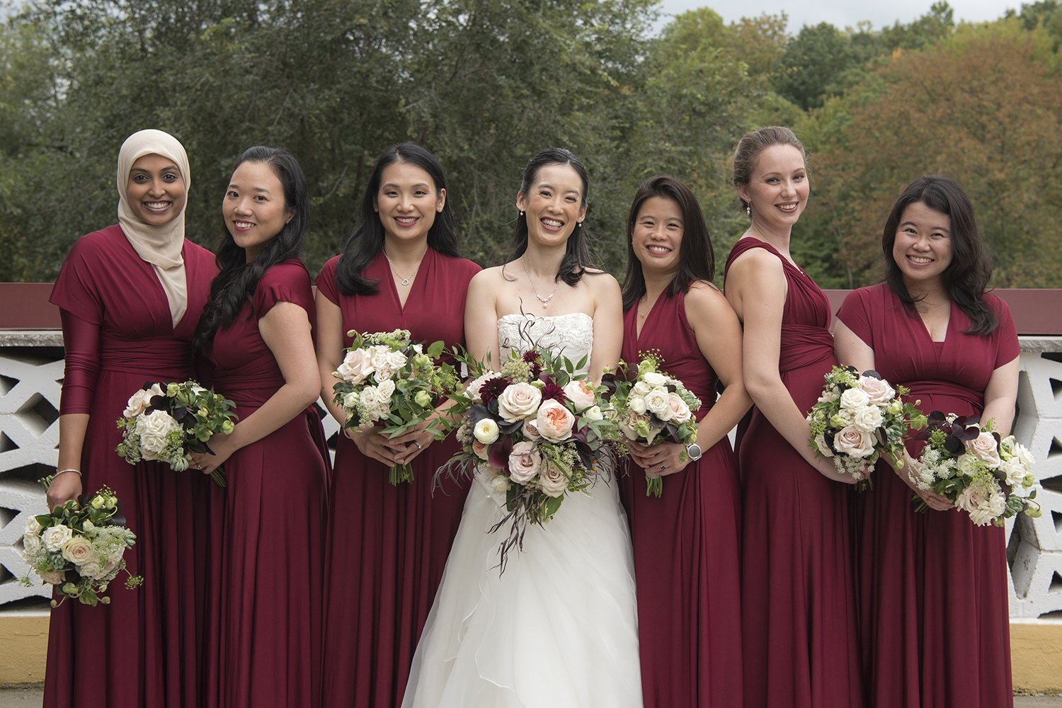 Diverse bridal party dressed in burgundy