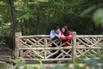 Couple on bridge during Central Park engagement session