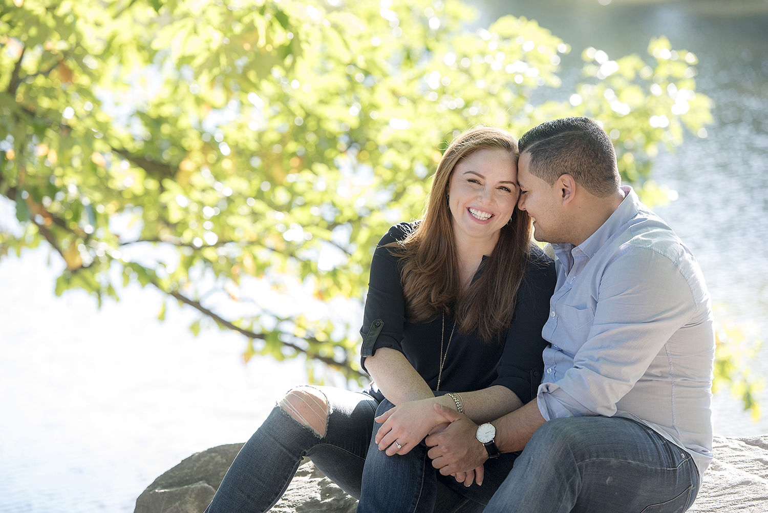Engaged couple in Central Park for their engagement session. NYC wedding photographer