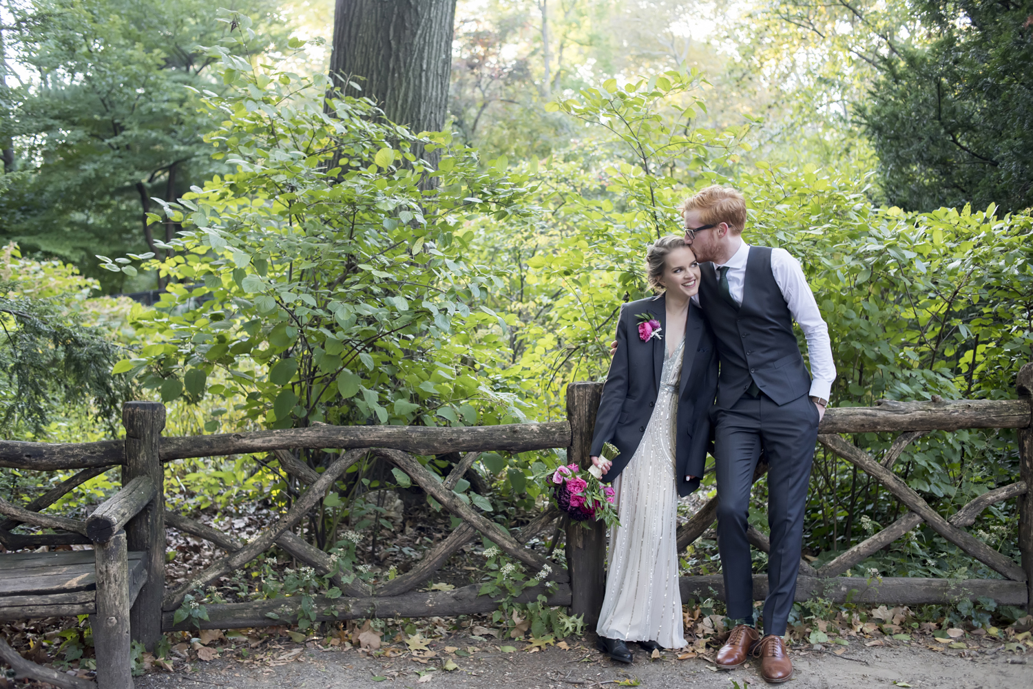 Bride and groom posing for portrait in Central Park